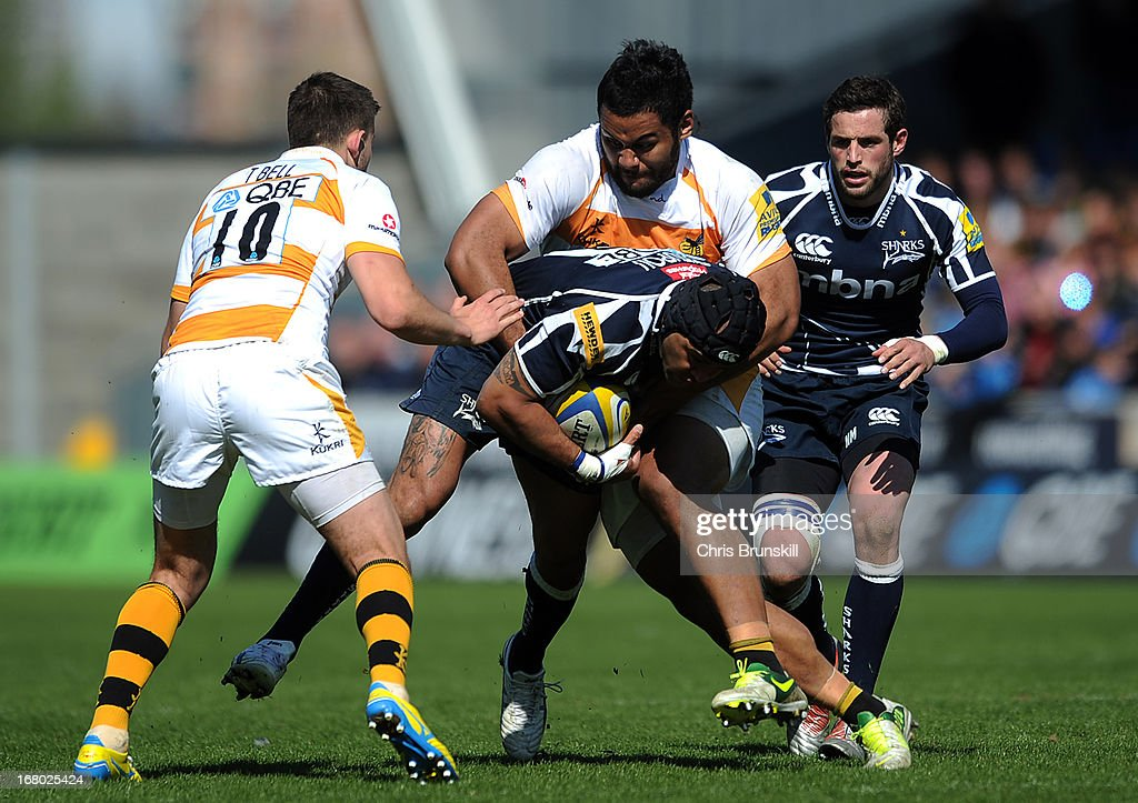 Sam Tuitupou of Sale Sharks is tackled by Billy Vunipola of London Wasps during the Aviva Premiership match between Sale Sharks and London Wasps at the Salford City Stadium on May 04, 2013 in Salford, England.