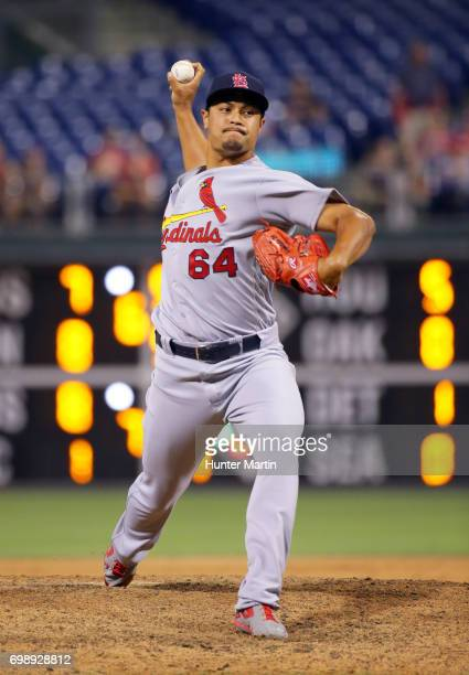 Sam Tuivailala of the St Louis Cardinals throws a pitch in the 11th inning during a game against the Philadelphia Phillies at Citizens Bank Park on...