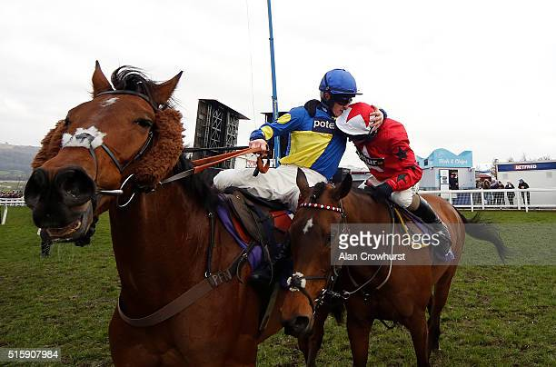 Sam TwistonDavies congratulates Ryan Hatch after he rides Blaklion to win The RSA Steeple Chase at Cheltenham racecourse on March 16 2016 in...