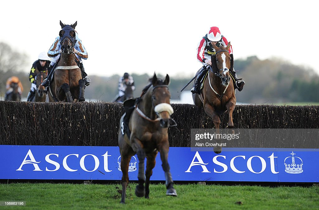 Sam Twiston-Davies riding Ackertac (R) clear the last to win The Winkworth handicap Steeple Chase from Vino griego (L) at Ascot racecourse on November 23, 2012 in Ascot, England.