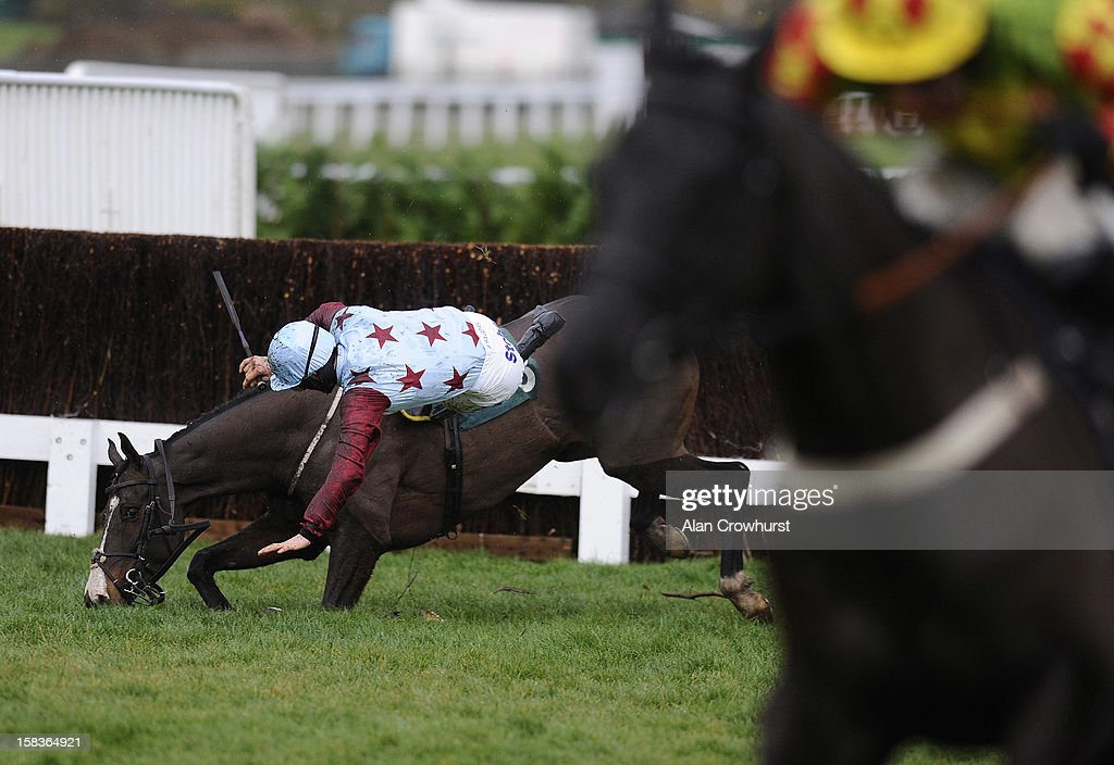 Sam Twiston-Davies riding Billie Magern fall at the last in The Majordomo Hospitality Handicap Steeple Chase at Cheltenham racecourse on December 14, 2012 in Cheltenham, England.