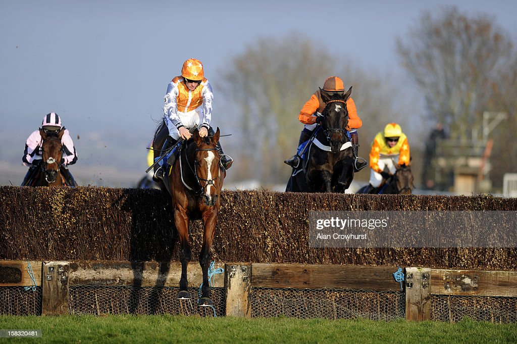 Sam Twiston-Davies riding Changing Times on their way to winning The Remembering Victor Thorne Novices' Limited Handicap Steeple Chase at Taunton racecourse on December 13, 2012 in Taunton, England.