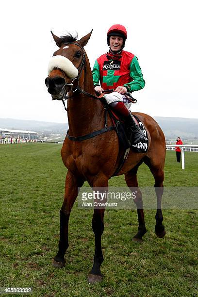 Sam TwistonDavies riding Dodging Bullets winThe Betway Queen Mother Champion Steepel Chase at Cheltenham racecourse on March 11 2015 in Cheltenham...