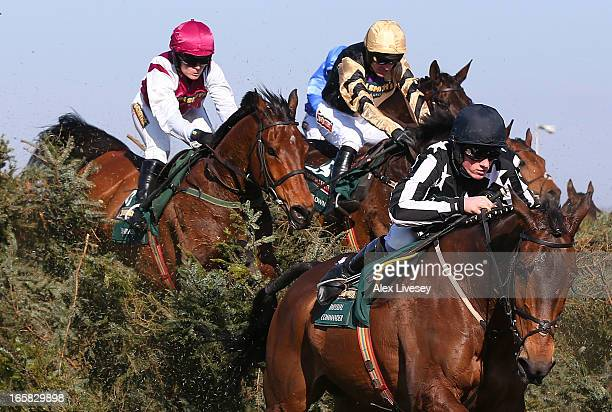 Sam TwistonDavies riding Imperial Commander leads Katie Walsh riding Seabass over the chair during the John Smiths Grand National Steeple Chase at...