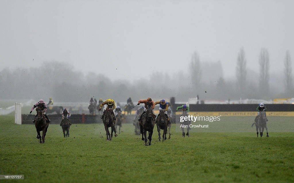 Sam Twiston-Davies riding Master Of The Sea (C, orange) win The Betfair Don't Settle For Less Handicap Hurdle Race at Newbury racecourse on February 09, 2013 in Newbury, England.