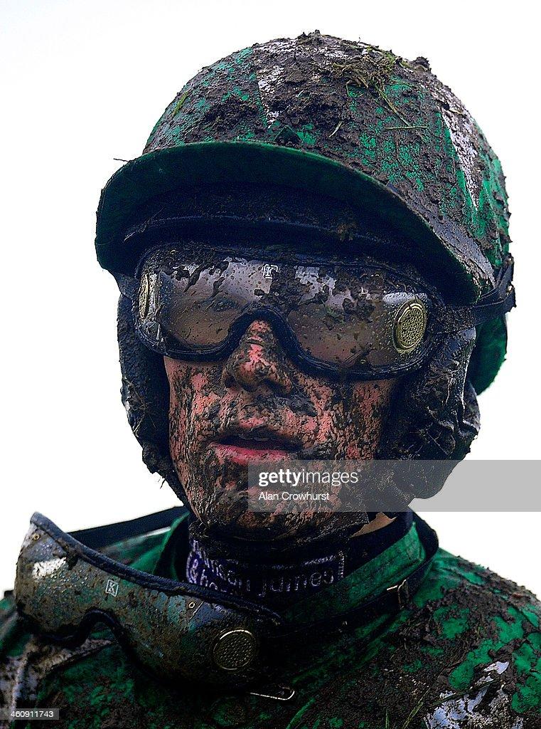 Sam TwistonDavies riding Pigeon Island return after pulling up at Cheltenham racecourse on January 01 2014 in Cheltenham England