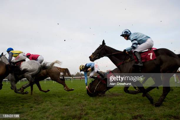 Sam TwistonDavies riding Westlin' Winds fall in The Listen To Timeform Radio Handicap Hurdle Race at Haydock racecourse on November 19 2011 in...
