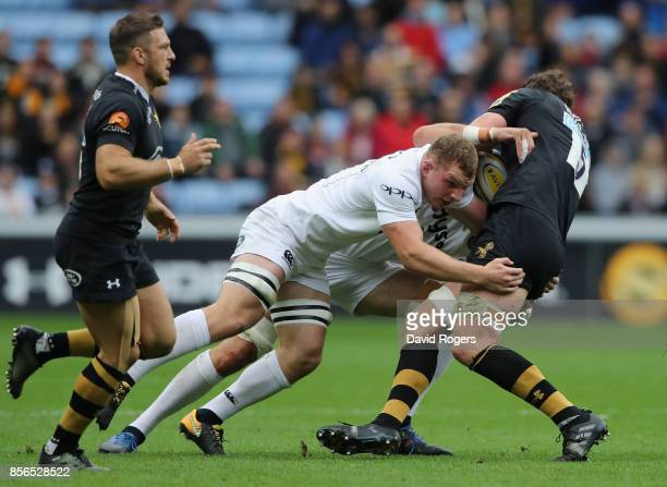 Sam Underhill of Bath tackles Will Rowlands during the Aviva Premiership match between Wasps and Bath Rugby at The Ricoh Arena on October 1 2017 in...