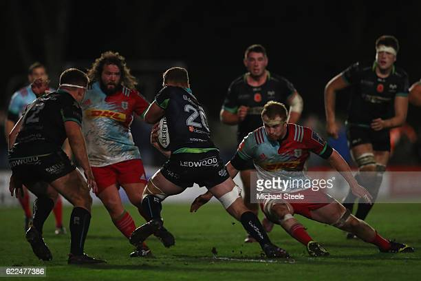 Sam Underhill of Ospreys sidesteps the challenge from James Chisholm of Harlequins during the AngloWelsh Cup match between Ospreys and Harlequins at...
