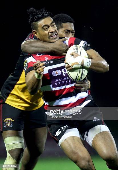 Sam Vaka of Counties Manukau is tackled by Pene Kamakorewa of Thames Valley during the Ranfurly Shield match between Counties Manukau and Thames...
