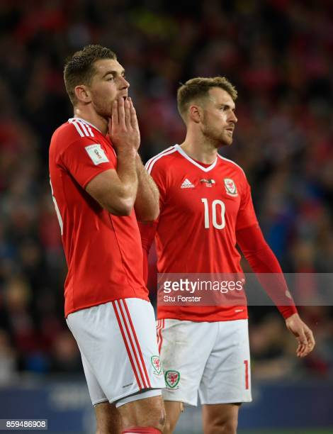 Sam Vokes and Aaron Ramsey react after the FIFA 2018 World Cup Qualifier between Wales and Republic of Ireland at Cardiff City Stadium on October 9...