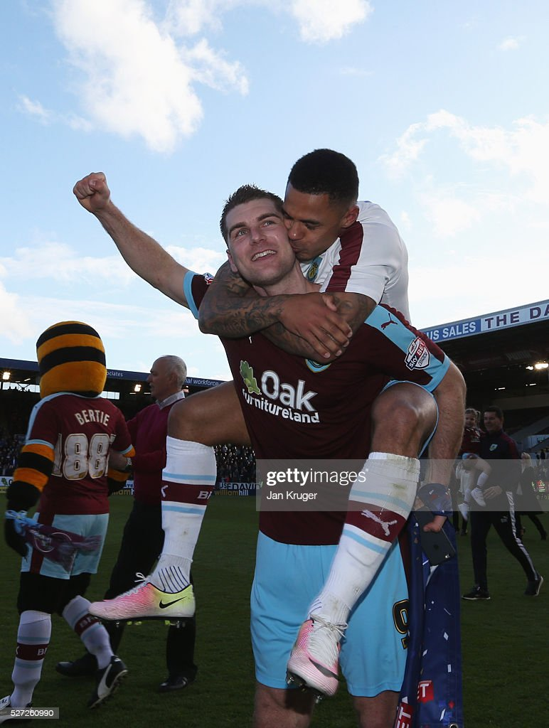 Sam Vokes and Andre Gray of Burnley celebrate as they are promoted to the Premier League after the Sky Bet Championship match between Burnley and...