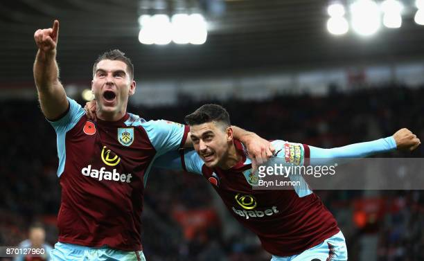 Sam Vokes celebrates scoring his side's first goal with Matthew Lowton of Burnley during the Premier League match between Southampton and Burnley at...