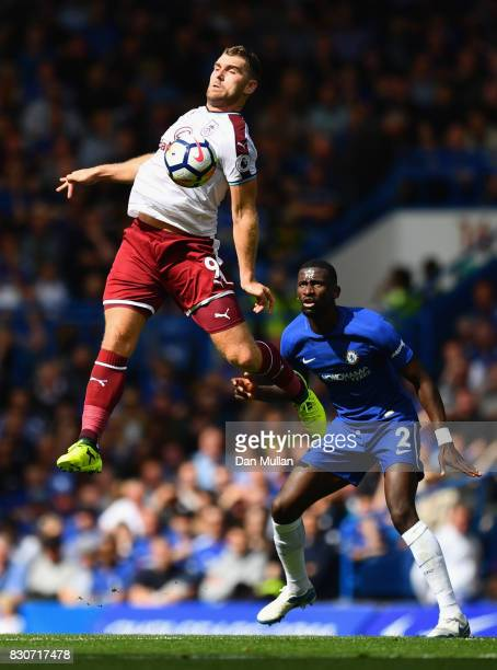 Sam Vokes of Burnley and Antonio Rudiger of Chelsea battle for possession during the Premier League match between Chelsea and Burnley at Stamford...