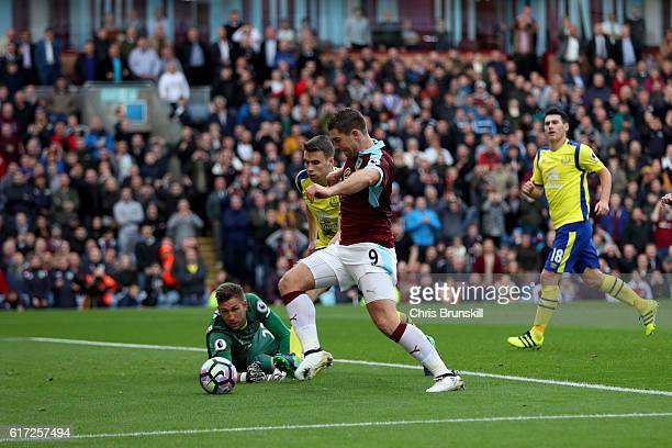 Sam Vokes of Burnley and Maarten Stekelenburg of Everton compete for the ball during the Premier League match between Burnley and Everton at Turf...