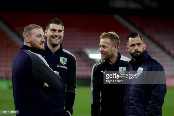 Sam Vokes of Burnley and Scott Arfield of Burnley speak with there team mates on the pitch prior to the Premier League match between AFC Bournemouth...