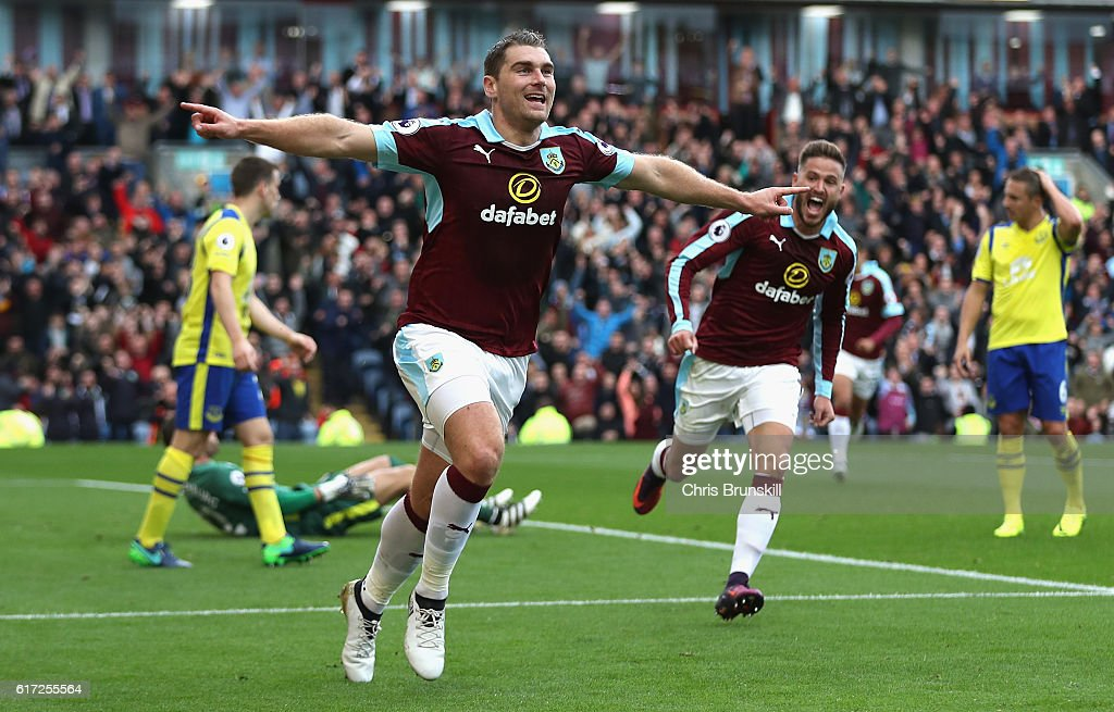 Sam Vokes of Burnley (C) celebrates scoring his sides first goal during the Premier League match between Burnley and Everton at Turf Moor on October 22, 2016 in Burnley, England.