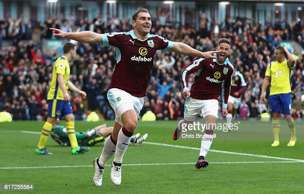 Sam Vokes of Burnley celebrates scoring his sides first goal during the Premier League match between Burnley and Everton at Turf Moor on October 22...