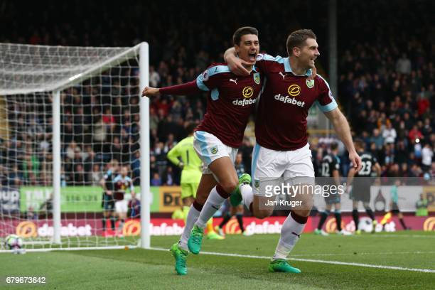 Sam Vokes of Burnley celebrates scoring his sides first goal with his Burnley team mate during the Premier League match between Burnley and West...