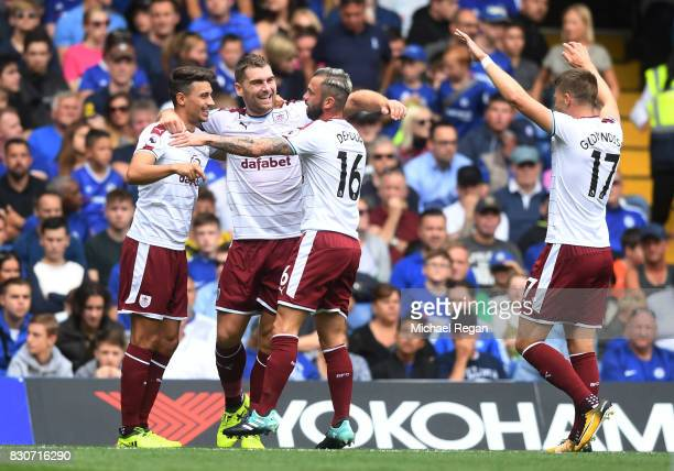 Sam Vokes of Burnley celebrates scoring his sides first goal with his Burnley team mates during the Premier League match between Chelsea and Burnley...
