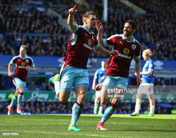 Sam Vokes of Burnley celebrates scoring his sides first goal with George Boyd of Burnley during the Premier League match between Everton and Burnley...