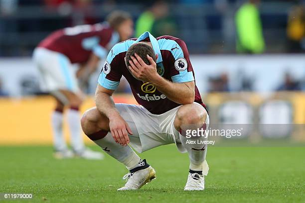 Sam Vokes of Burnley holds his head in his hands after the final whistle during the Premier League match between Burnley and Arsenal at Turf Moor on...