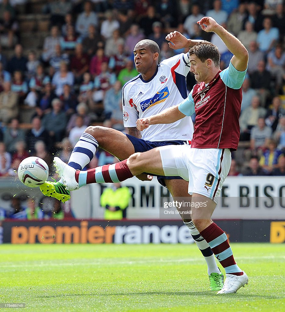 Sam Vokes of Burnley in action with <a gi-track='captionPersonalityLinkClicked' href=/galleries/search?phrase=Zat+Knight&family=editorial&specificpeople=213629 ng-click='$event.stopPropagation()'>Zat Knight</a> of Bolton Wanderers during the Sky Bet Championship match between Burnley and Bolton Wanderers at Turf Moor on August 03, 2013 in Burnley, England.