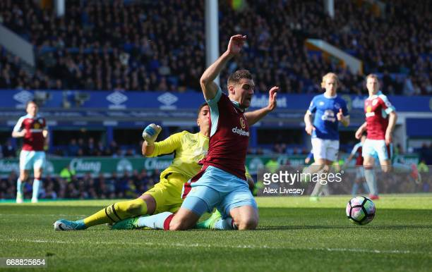 Sam Vokes of Burnley is fouled by Joel Robles of Everton and a penalty is awarded during the Premier League match between Everton and Burnley at...