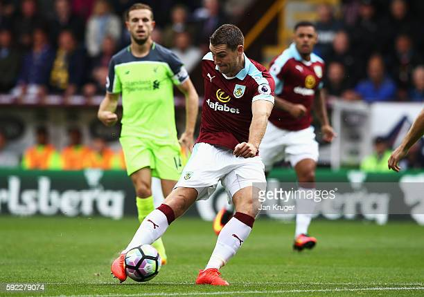 Sam Vokes of Burnley scores his sides first goal during the Premier League match between Burnley and Liverpool at Turf Moor on August 20 2016 in...