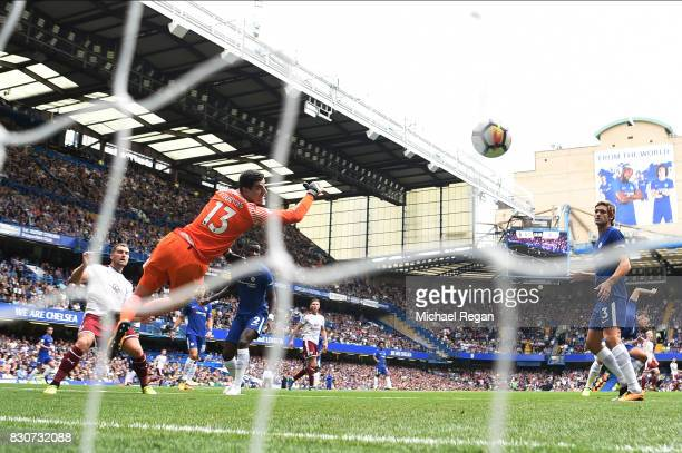 Sam Vokes of Burnley scores his sides opening goal past Thibaut Courtois of Chelsea during the Premier League match between Chelsea and Burnley at...