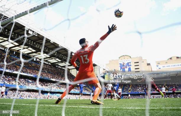 Sam Vokes of Burnley scores his sides third goal past Thibaut Courtois of Chelsea during the Premier League match between Chelsea and Burnley at...