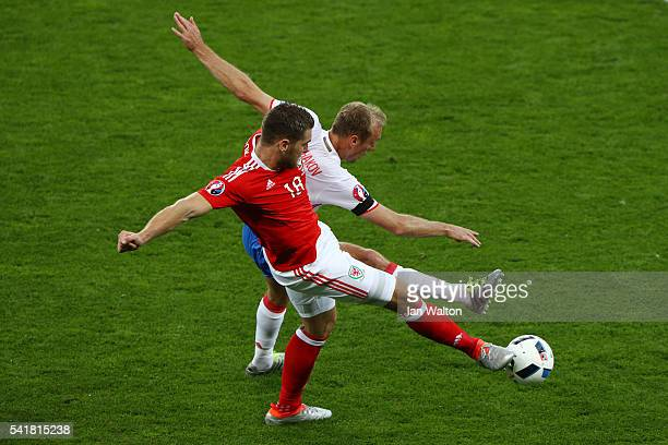 Sam Vokes of Wales and Denis Glushakov of Russia compete for the ball during the UEFA EURO 2016 Group B match between Russia and Wales at Stadium...