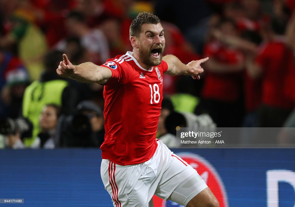 <a gi-track='captionPersonalityLinkClicked' href=/galleries/search?phrase=Sam+Vokes&family=editorial&specificpeople=4778614 ng-click='$event.stopPropagation()'>Sam Vokes</a> of Wales celebrates after scoring a goal to make it 3-1 during the UEFA Euro 2016 quarter final match between Wales and Belgium at Stade Pierre-Mauroy on July 1, 2016 in Lille, France.