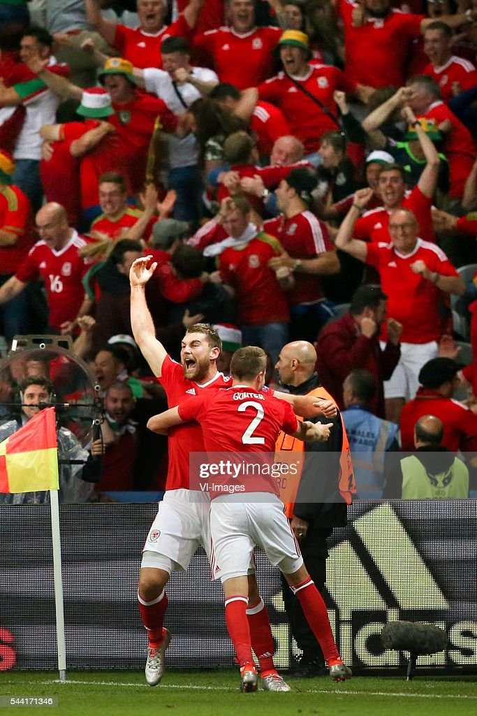 Sam Vokes of Wales celebrates scoring 3-1, Chris Gunter of Wales during the UEFA EURO 2016 quarter final match between Wales and Belgium on July 2, 2016 at the Stade Pierre Mauroy in Lille, France.