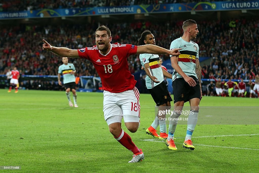 <a gi-track='captionPersonalityLinkClicked' href=/galleries/search?phrase=Sam+Vokes&family=editorial&specificpeople=4778614 ng-click='$event.stopPropagation()'>Sam Vokes</a> of Wales celebrates scoring his side's third goal during the UEFA Euro 2016 Quarter Final match between Wales and Belgium at Stade Pierre-Mauroy on July 1, 2016 in Lille, France.
