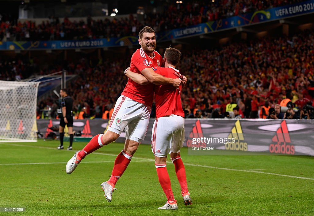 <a gi-track='captionPersonalityLinkClicked' href=/galleries/search?phrase=Sam+Vokes&family=editorial&specificpeople=4778614 ng-click='$event.stopPropagation()'>Sam Vokes</a> (L) of Wales celebrates scoring his team's third goal with his team mates <a gi-track='captionPersonalityLinkClicked' href=/galleries/search?phrase=Chris+Gunter+-+Welsh+Soccer+Player&family=editorial&specificpeople=4196407 ng-click='$event.stopPropagation()'>Chris Gunter</a> (R) during the UEFA EURO 2016 quarter final match between Wales and Belgium at Stade Pierre-Mauroy on July 1, 2016 in Lille, France.