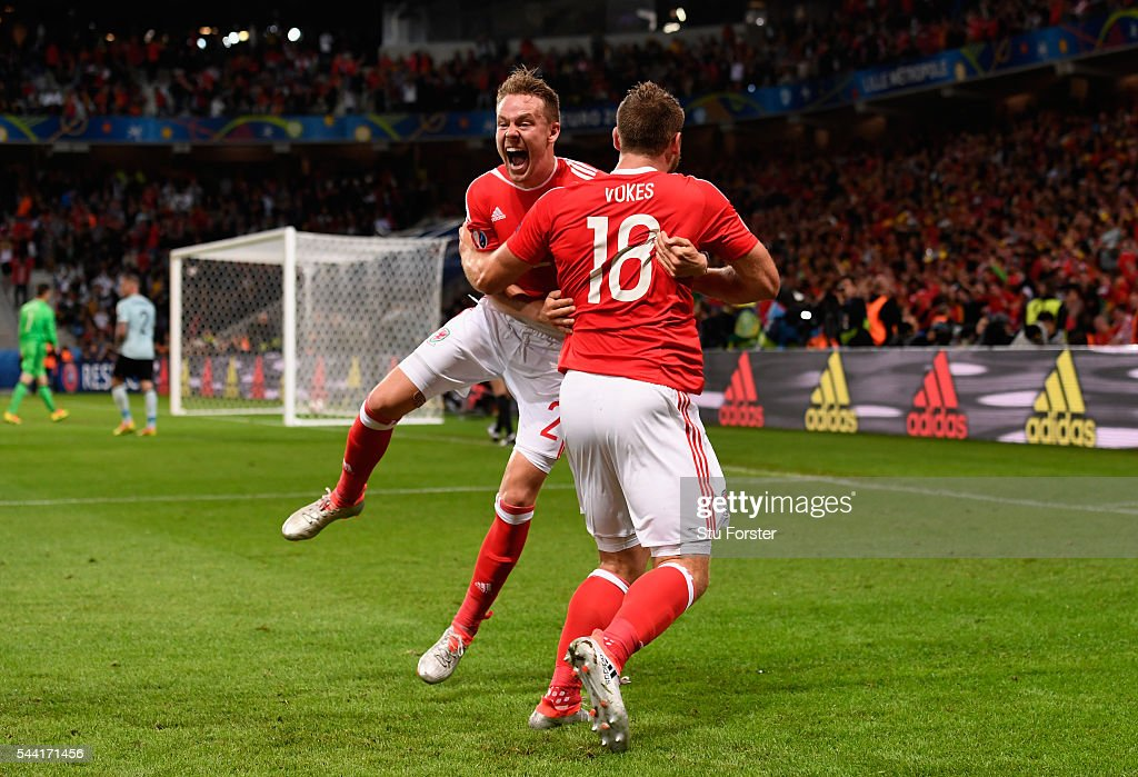 <a gi-track='captionPersonalityLinkClicked' href=/galleries/search?phrase=Sam+Vokes&family=editorial&specificpeople=4778614 ng-click='$event.stopPropagation()'>Sam Vokes</a> (R) of Wales celebrates scoring his team's third goal with his team mates <a gi-track='captionPersonalityLinkClicked' href=/galleries/search?phrase=Chris+Gunter+-+Welsh+Soccer+Player&family=editorial&specificpeople=4196407 ng-click='$event.stopPropagation()'>Chris Gunter</a> (L) during the UEFA EURO 2016 quarter final match between Wales and Belgium at Stade Pierre-Mauroy on July 1, 2016 in Lille, France.
