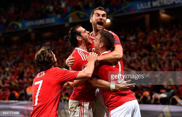 Sam Vokes of Wales celebrates scoring his team's third goal with his team mates during the UEFA EURO 2016 quarter final match between Wales and...