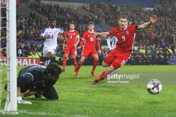 Sam Vokes of Wales pounces onto the loose ball as Jaime Penedo of Panama saves his penalty during the International Friendly match between Wales and...