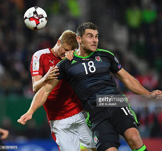 Sam Vokes of Wales vies with Austria's Florian Klein vie during the WC 2018 football qualification match between Austria and Wales in Vienna on...