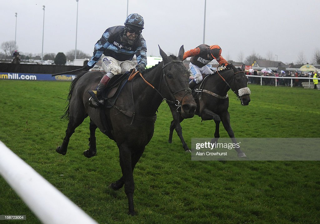 Sam Waley-Cohen riding Long Run (R) clear the last to win The William Hill King George VI Steeple Chase from Captain Chris (L) at Kempton racecourse on December 26, 2012 in Sunbury, England.
