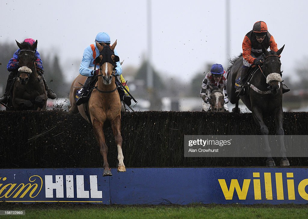 Sam Waley-Cohen riding Long Run (R) on their way to winning The William Hill King George VI Steeple Chase at Kempton racecourse on December 26, 2012 in Sunbury, England.