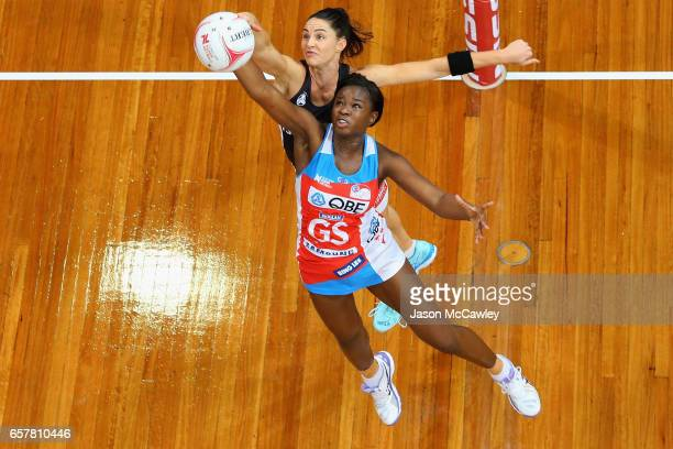 Sam Wallace of the Swifts and Sharni Layton of the Magpies compete for the ball during the round six Super Netball match between the Swifts and the...