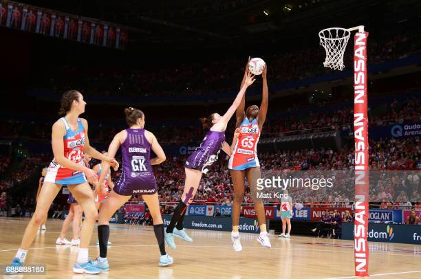 Sam Wallace of the Swifts is challenged by Kate Shimmin of the Firebirds during the round 14 Super Netball match between the Swifts and the Firebirds...