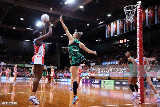 Sam Wallace of the Swifts shoots as Courtney Bruce of the Fever defends during the round 11 Super Netball match between the Swifts and the Fever at...