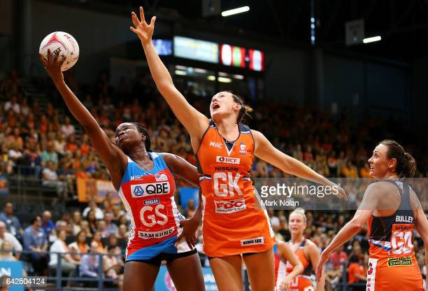 Sam Wallace of the Swifts takes a pass during round one of the Super Netball between the Giants and Swifts at Sydney Olympic Park Sports Centre on...