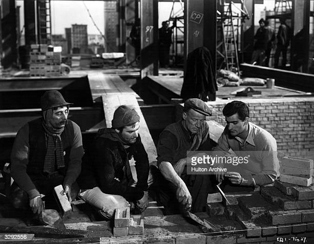 Sam Wanamaker Charles Goldner and Bonar Colleano play bricklayers in a scene from the Plantagenet film 'Give Us This Day' directed by Edward Dmytryk