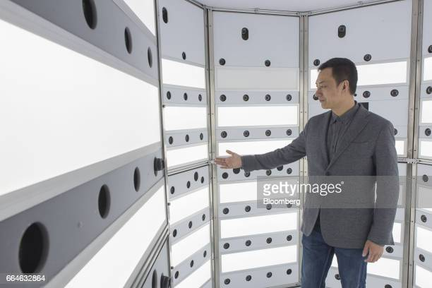 Sam Wang cofounder of Sky Limit Entertainment Group stands inside a studio equipped with 200 cameras that create a computerized avatar of visitors at...