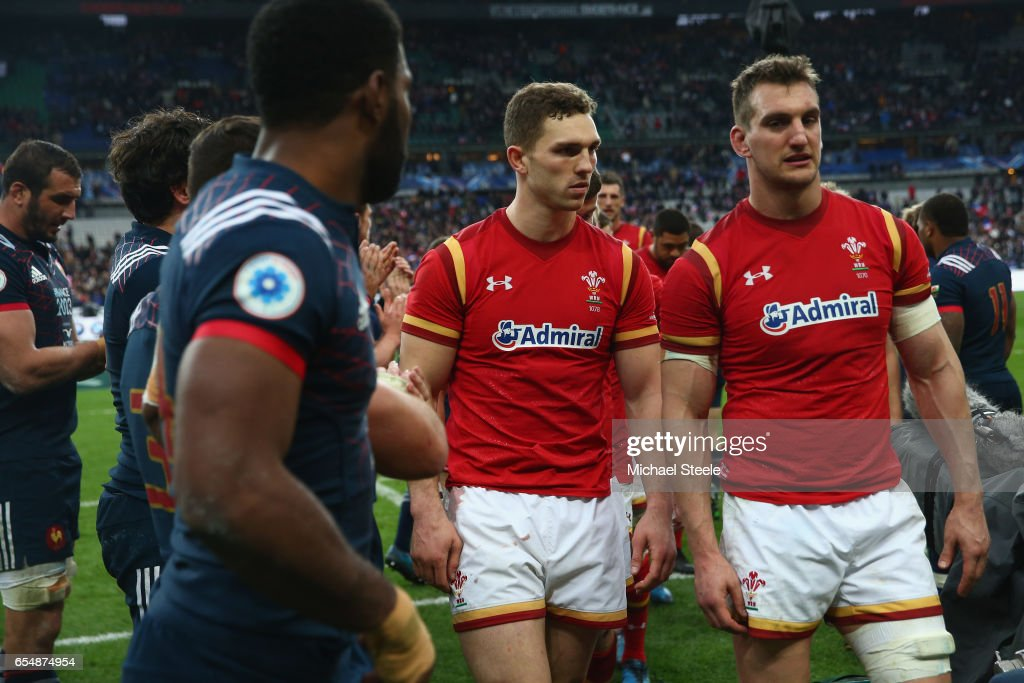 Sam Warburton (R) and George North (C) walk past Noa Nakaitaci (L) of France after their sides 18-20 defeat during the RBS Six Nations match between France and Wales at Stade de France on March 18, 2017 in Paris, France.