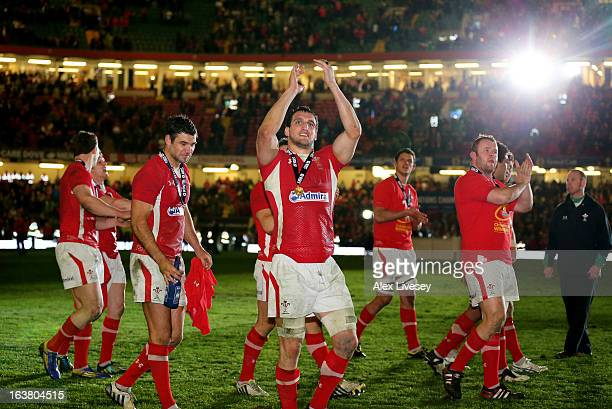 Sam Warburton and teammates celebrate following their team's victory during the RBS Six Nations match between Wales and England at Millennium Stadium...